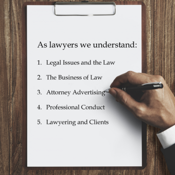 Business man hand writing on clipboard on wood desktop explaining our knowledge of the law and legal field